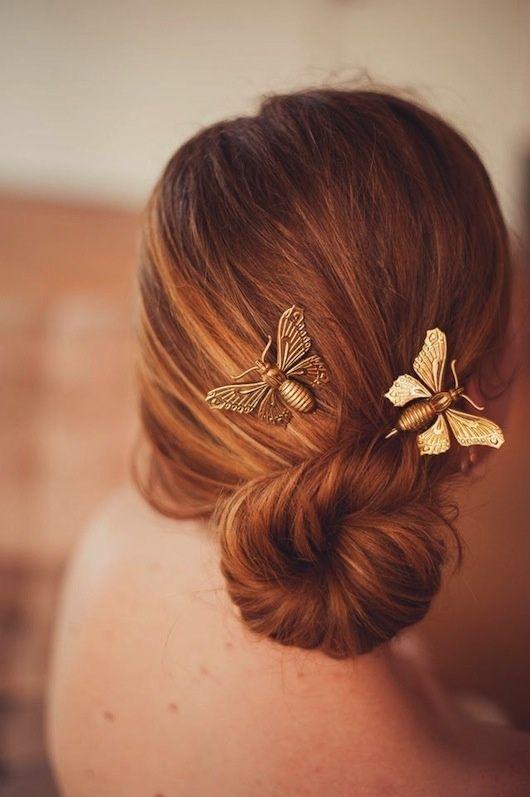 Gold moth hair pins.