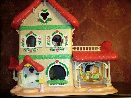 Strawberry Shortcake Doll House!!! It was complete with furniture. My sisters and I had most of the dolls as well.