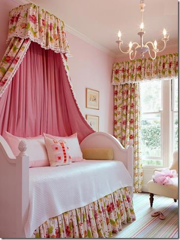 In this sweet little girl's room San Francisco-based designer, Palmer Weiss makes a dramatic statement with a crown canopy.
