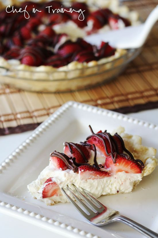 INGREDIENTS 1 cooked pie crust Cook according to pie crust directions.  1 cup heavy whipping cream 8 oz cream cheese softened 1/3 cup sugar 1/2 tsp. vanilla or almond extract 18-20 strawberries cut in halves 1 Tbsp. shortening or oil 1/2 cup milk chocolate chips