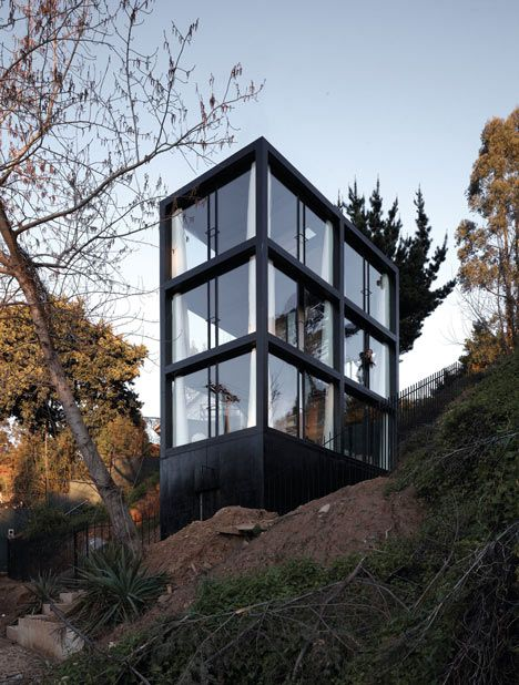 Casa Arco. This earthquake-proof house on a hillside in western Chile designed by architects Pezo von Ellrichshausen has six rooms with glass walls.