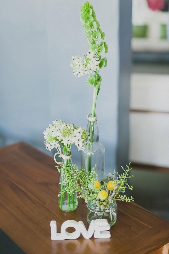assorted glass jar vases + wood love sign