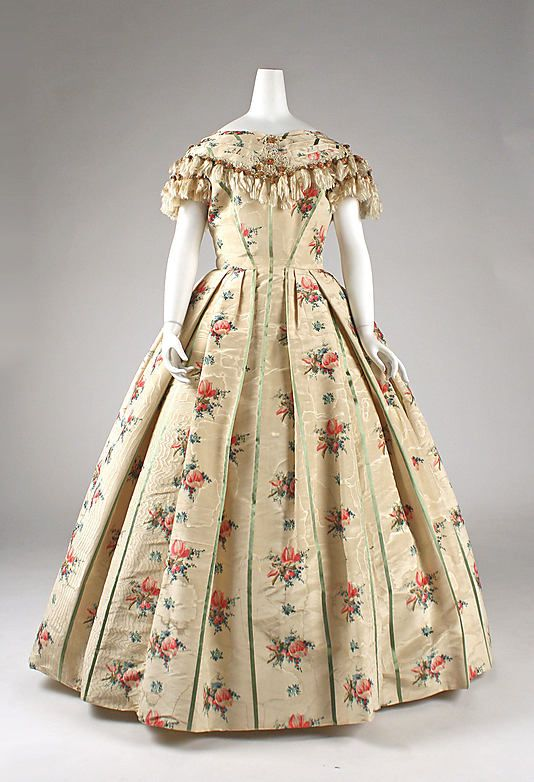 Floral-print silk evening dress with tassel trim on bodice, French, 1856-57. Has a partially-constructed alternate bodice.