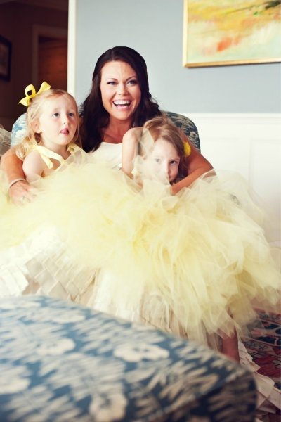 flower girls in yellow tulle Photography by Maggie Conley Photography / maggieconleyphoto..., Event Design   Coordination by TRUE Event / trueevent.com, Floral Design by Hana Floral Design / hanafloraldesign.com #FlowerGirl #Tulle