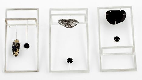 "New City by Galit Barak - 2011 - Called New City, the series of rings and brooches features rough-cut stones framed by rectangles and protruding from the side or between fingers. -Silver plated Alpaca, Onyx, Jasper, Tourmalinated Quartz- Created during the course ""Jewel Writes"" by Professor Dganit Stern Schocken, Jewelry Design Department, Shenkar Collage for Engineering and Design."