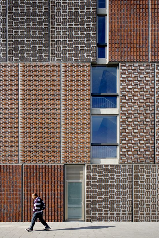 Precast concrete panels with cast-in bricks on the facade of Block A Noordstrook in Amsterdam, The Netherlands by Dick van Gameren Architecten
