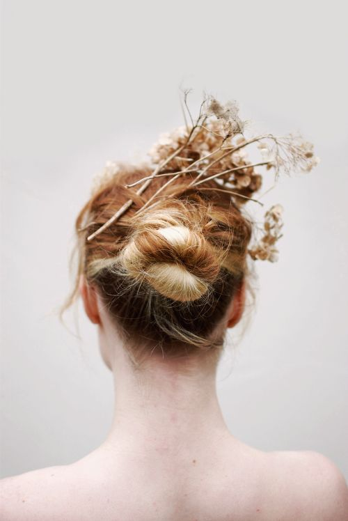 dried flowers in her hair