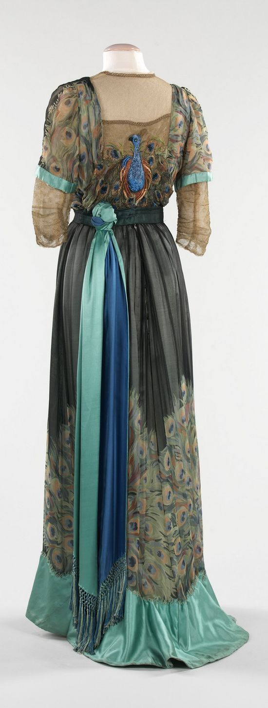 Love the peacock theme on the back of this 1910 French evening dress.