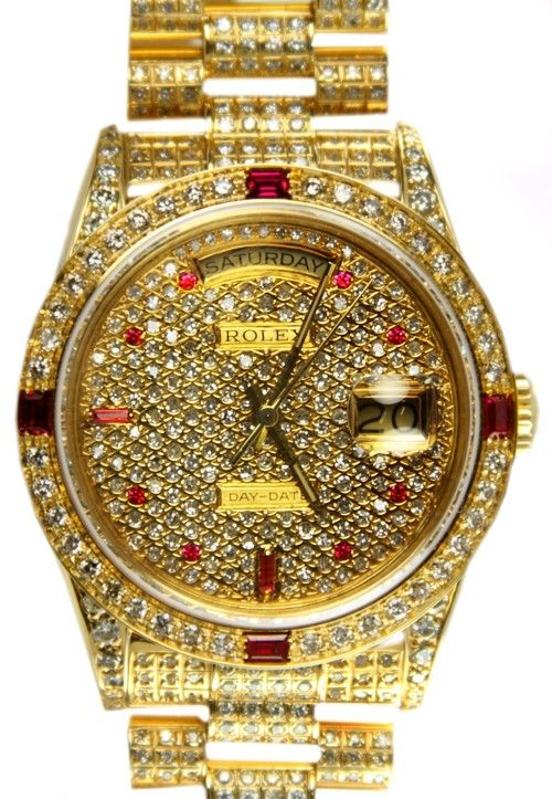 Gold, diamond, and ruby rolex....