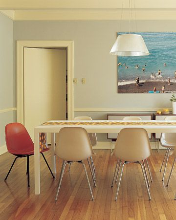 Dining Room with large beach photograph.
