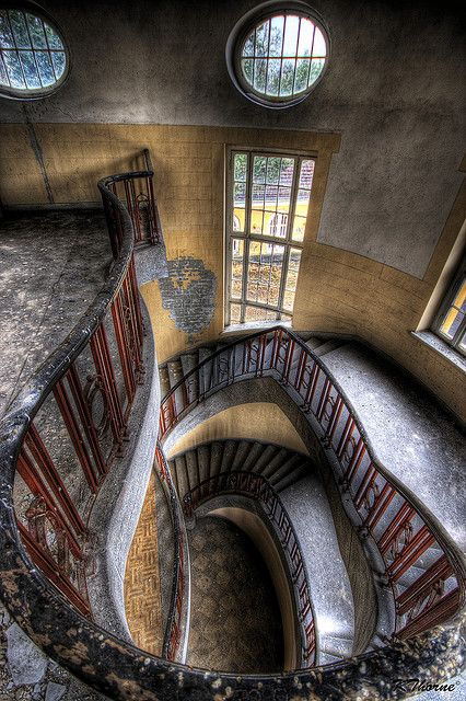 I adore this crazy, curvy staircase and the windows in this unique abandoned building.  So cool.