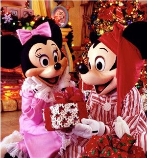 I would love to go to Disney at Christmas at least once...I will always be a kid at heart I know :)