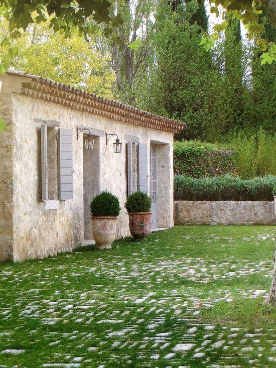 rocky grass. french cottage. patio. garden. Interior Design. Pinned by interior designer Anna Hackathorn www.annahackathor...