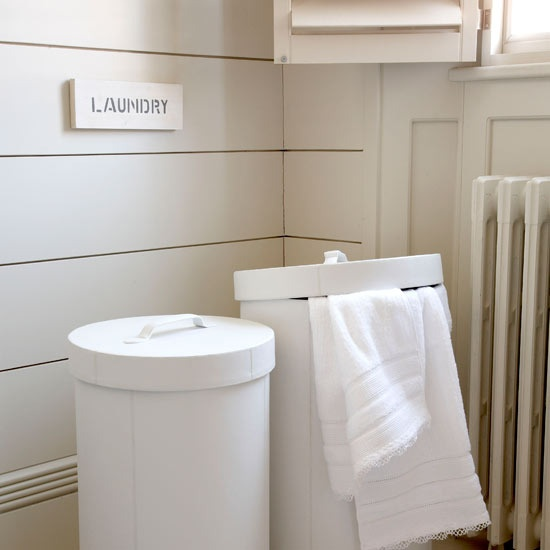 white cylinder hampers. these babies would be perfect not only for dirty clothes but for hangers too.