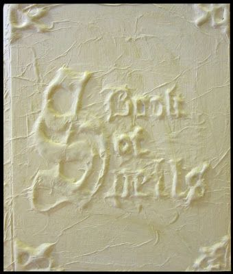 That is a FABULOUS way to make a 3D relief over a book cover - or any surface.  Love it.