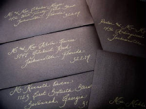 Calligraphy on Wedding Invitations  Gold in on Metallic brown envelopes. never thought of this color pallet for envelopes but it fits the fall theme :)
