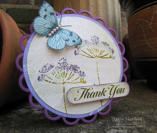 handmade card ... round die cut card  ... colllage stamping  and a dimensional die cut butterfly ... lovely!!