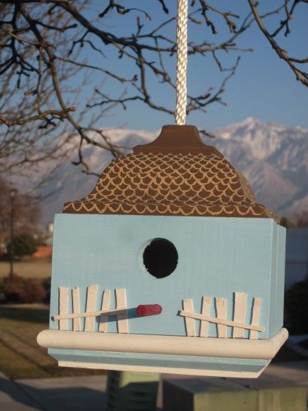 Assorted birdhouse creations (with random objects).