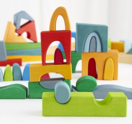 Brilliantly hued blocks in mid century shapes. I'd like a set, please.