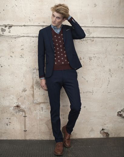 Gant Rugger Pre-fall. Navy blue suit with brown sweater vest and shoes.