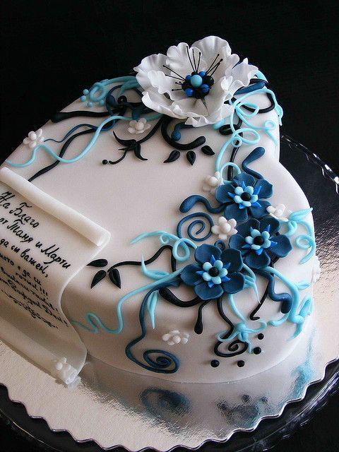 White, blue and black cake