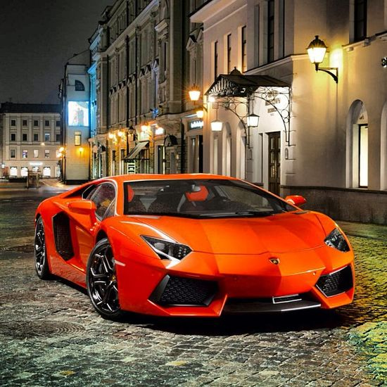 Orange Lamborghini Aventador, strolling through the town