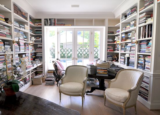office with walls of book shelves, yes please.
