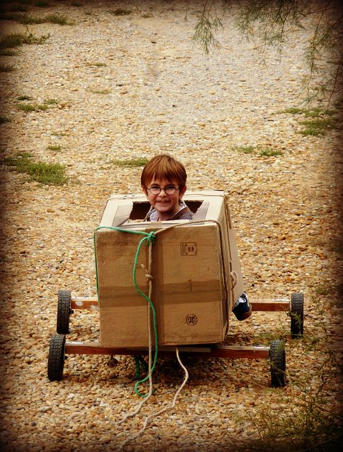 Miles invented a new toy this morning - the box-cart!     Kickcan & Conkers