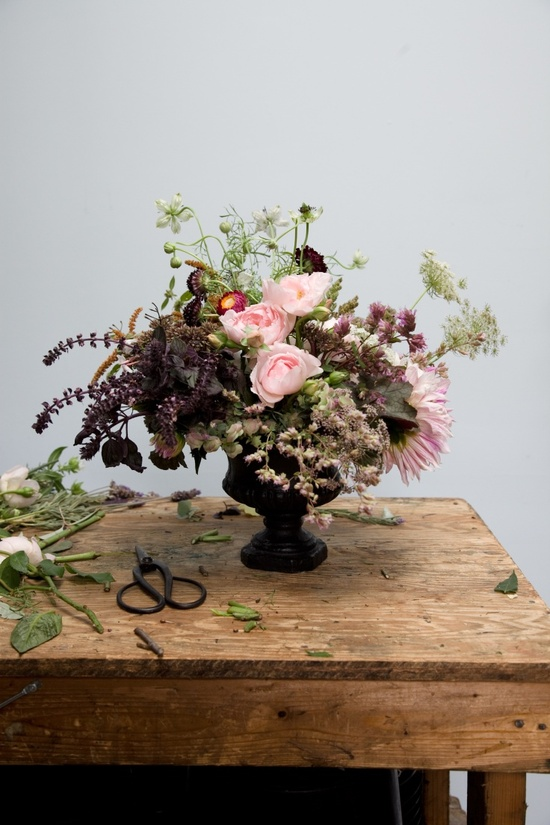 A floral centerpiece in an urn, with a vintage look. (Photo: Robert Wright for The New York Times)