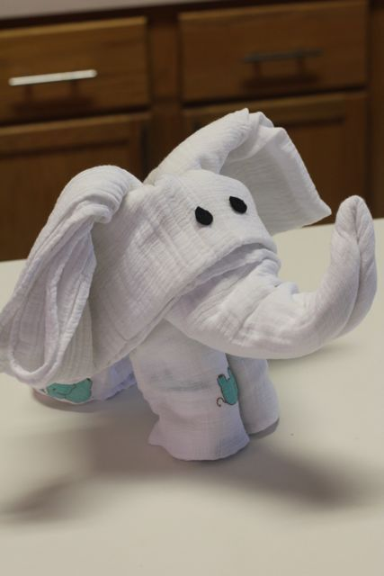 Turn Swaddling Blankets Into An Elephant. Cute to put in a basket for baby shower gift.