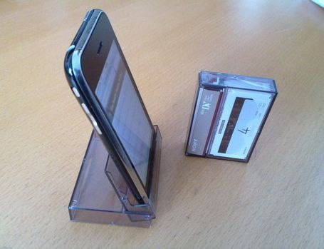Old technology meet new tech- cassette tape case used as smart phone stand.