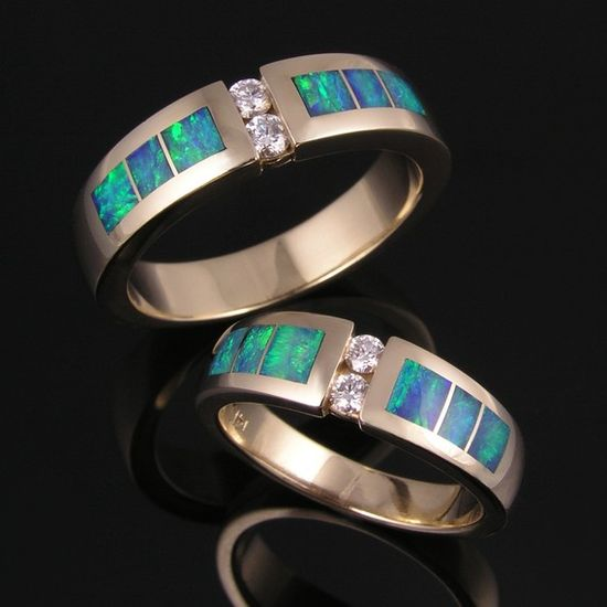 Opal and diamond wedding ring set.  Matching his and hers opal wedding rings in 14k gold with diamond accents.