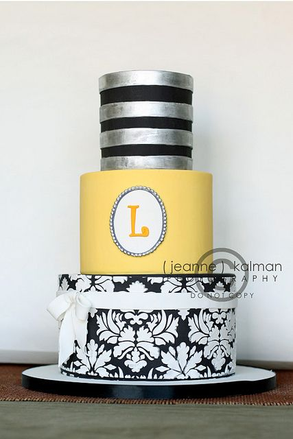 silver and yellow wedding cake