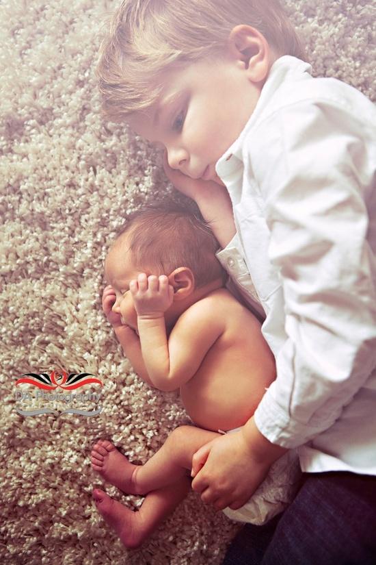 Brother & newborn sister portrait