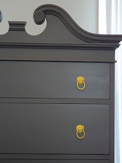 painted furniture with yellow knobs.