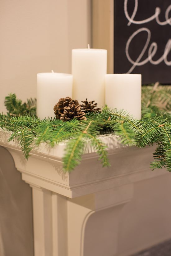 White Fireplace Mantle with Christmas Decor, + Candles - Dura Supreme Mantles