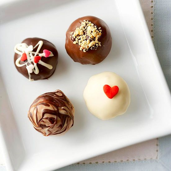 No-Bake Truffle Treats //  Dote on your valentine with candies that look oh-so-charming but are finished in about half an hour. With four flavors, one (or more) is sure to appeal to your valentine. More simply sweet Valentine's Day Dessert Recipes: www.bhg.com/...