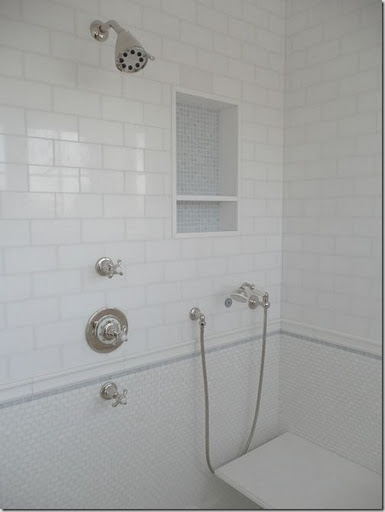 Bathroom inspiration - love the mix of small intricate tile with the border against the clean subway tile
