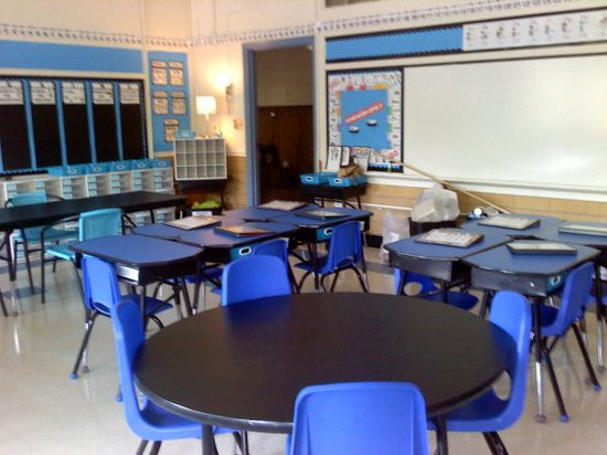 These desks were covered in contact paper on to hide their worn out-ness...a must do for my new room! Wonder if you could do it in blackboard or whiteboard paper and the stds can write on them!