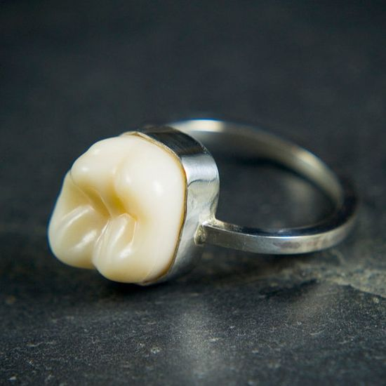 Making a ring of your kids milk tooth... not sure what to think about this either~