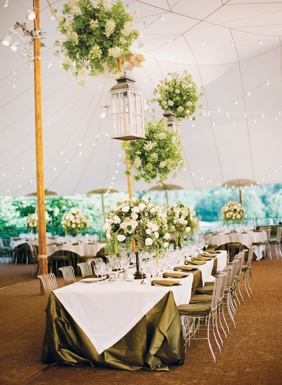 tent wedding--photo by Katie Stoops. Sperry tent by Skyline Tents in Charlottesville. Green and White Linens by LaTavola. Green and white Flowers by Lavender Green. Silver Chairs from DC Rentals. at home, backyard wedding and reception by Bellwether Events.
