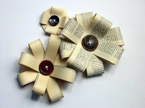 Paper and a button to create a flower-bow. Look great on a brown paper bag-wrapped gift!