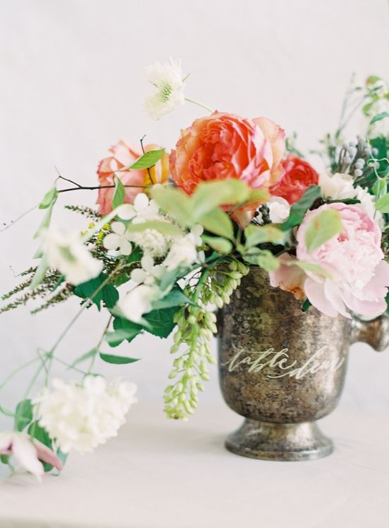vintage urn and colourful flowers - not too arranged.