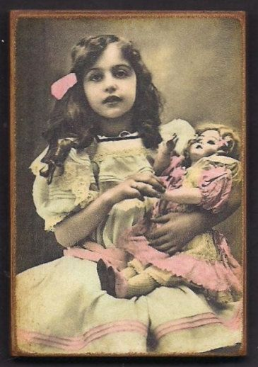 Tinted Vintage Photo of a Victorian Little Girl and Doll.