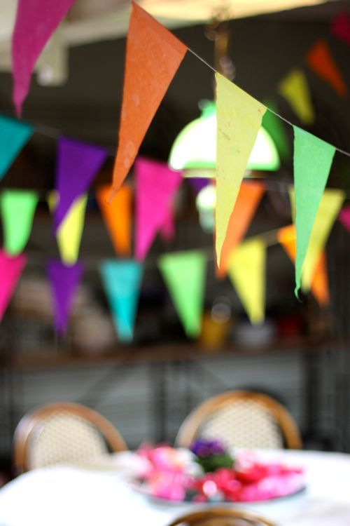 Colorful garland, perfect birthday party decor-- I like blue, orange & yellow for a boy party