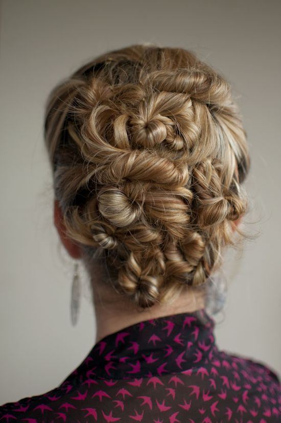 complicated-looking updo with pinned curls