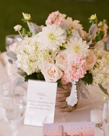 Roses, hydrangeas, and dahlias in a soft pink-and-white palette