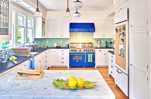 White kitchen with a splash of color. Also, love the cork board fridge!