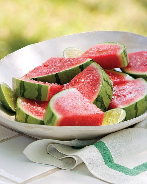 Tequila-Soaked Watermelon Wedges by marthastewart:  Tequila and Triple Sec infuse the watermelon slices, which also get a spray of lime juice and a sprinkling of coarse salt. The longer the watermelon soaks, the more flavorful it becomes -- one more reason to save any leftover slices.  #Watermelon #Tequila