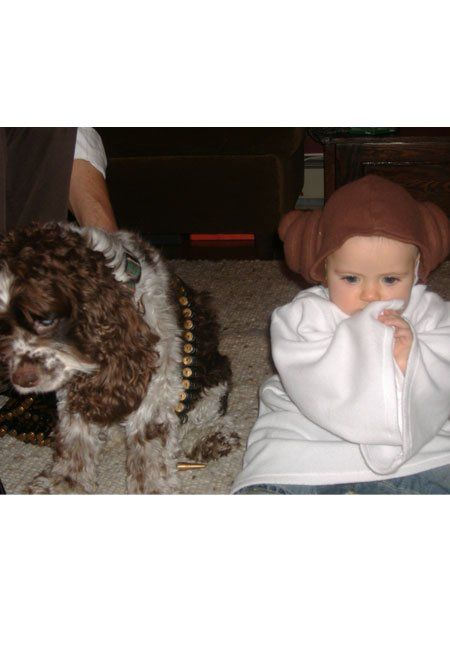 It's the adorable Princess Leia and Chewbacca. Cute kids and their dogs.